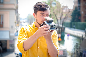 hipster young man with polaroid