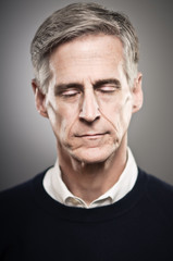Mature Caucasian Man With His Eyes Closed Portrait