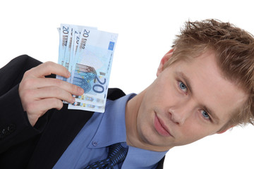 Landscape picture of young man with money