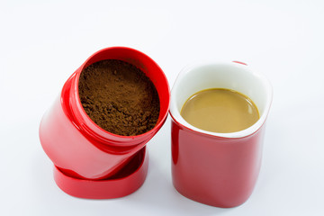 red cup of coffee isolated over white background