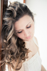 Portrait of beautiful young happy smiling woman with long curly