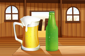 A beer and a bottle of softdrink at the table