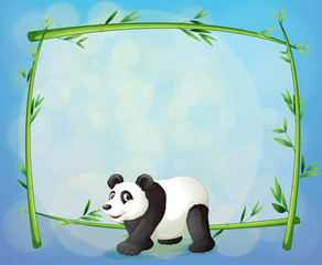 A panda with a framed bamboo tree at the back