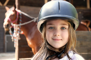 Little girl and brown Horse