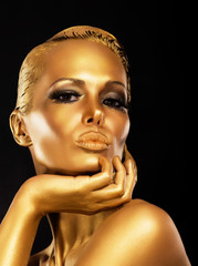 Fantasy. Styled Enigmatic Woman with Gold Make-up. Luxury