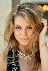Portrait of beautiful girl with gold jewelery with pearls