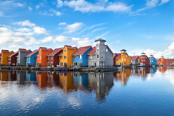 Wall Mural - Reitdiephaven - colorful buildings on water