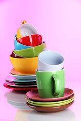 Mountain colorful dishes on pink background