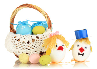 Easter eggs and two chicken toys isolated on white