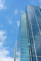 Fotobehang Aan het plafond Skyscraper with clouds reflection