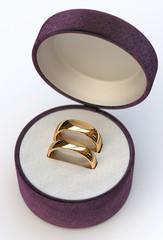 Wedding rings in purple jewel box
