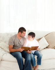 Father and son reading a fairy tale