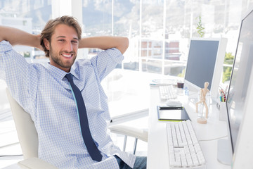 Smiling designer at his desk