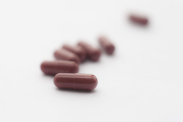 Brown pills on a white background