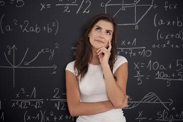 Female student thinking about mathematics problem