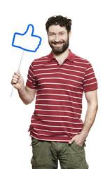 Man holding a social media sign smiling
