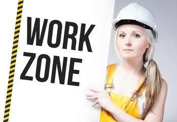 Worker holding work zone sign on information board