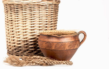 wattled basket, clay jug, cone, rope on a white background
