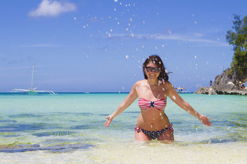 young beautiful happy woman on tropical beach and sea background