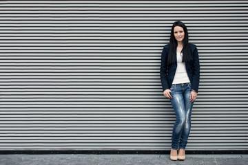 Woman portrait at striped wall