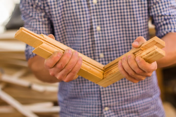 man holds a wooden product