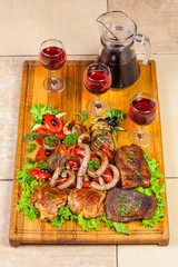 grilled meat, sausages  and  herbs with wine