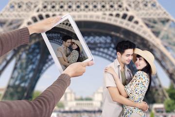 Romantic couple under Eiffel Tower Paris