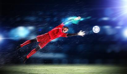 Wall Murals Football Goalkeeper catches the ball