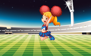 A soccer field with an energetic cheerdancer