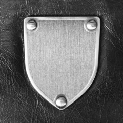 Metal badge against the black leather
