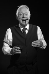 Retro senior business man with whisky smoking cigar. Black and w