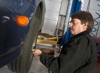 Automotive Technician Uses Pneumatic Impact Wrench Auto Repair B