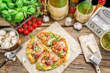 Split baked pizza with fresh vegetables
