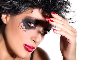 Beautiful Brunette with creative makeup. Smokey Eyes