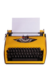 yellow typewriter with white paper