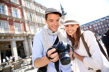 Couple looking at picture shots of Spanish travel journey