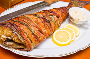 Fish wrapped in bacon