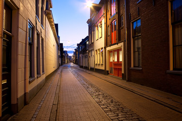 Wall Mural - long street at night in Groningen, Netherlands