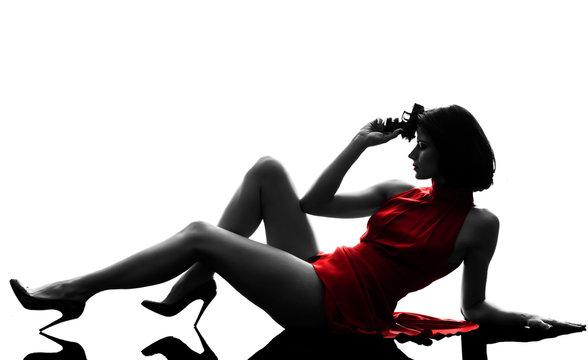 sexy woman holding gun  silhouette