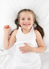 cheerful girl in bed