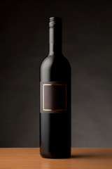 Black wine bottle with empty label