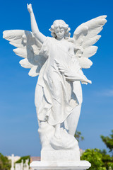 White marble statue of a young female angel