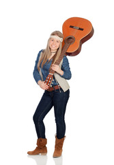 Pretty girl with hippie clothes and a guitar