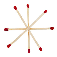 Matchsticks with red heads grouped in a star