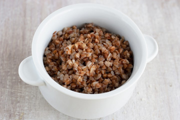 boiled buckwheat in the white plate