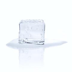 Melting ice cube isolated on white