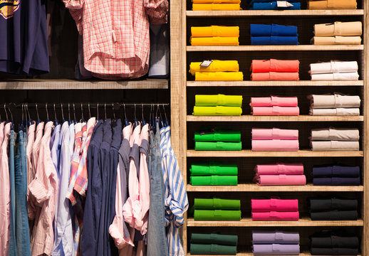 Colour shirts at shelf in shop