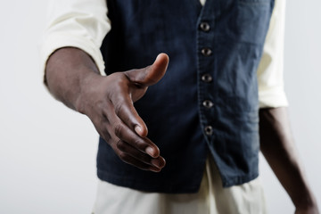 African American man shaking hands with caucasian man