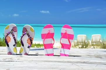 Flip-flops against ocean. Exuma, Bahamas