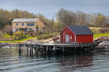 Traditional Norwegian red wooden fishing boat barn